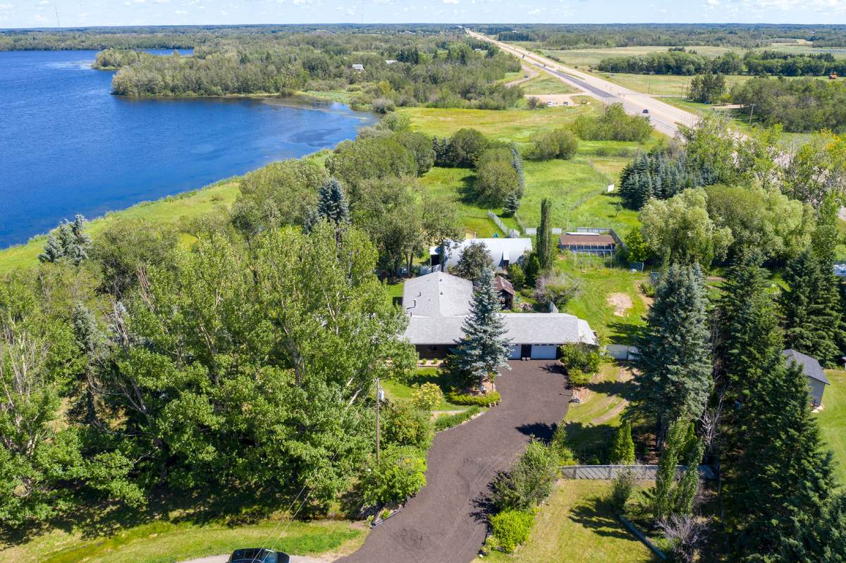 Acreage / Detached House / House / Land with Building(s) / Waterfront Property For Sale in Sherwood Park, AB - 3 bed, 2.5 bath