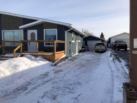 Duplex For Sale in Fort McMurray, AB - 3+1 bdrm, 2 bath (105 Sifton Ave)