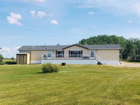 Mobile Home / Acreage For Sale in Langdon, AB - 3 bdrm, 2 bath (233133 Boundary Rd.)