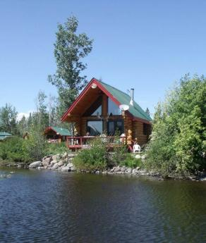 Business with Property / Business / Land with Building(s) / Revenue Property / Waterfront Property For Sale in Nimpo Lake, BC - 4 bdrm, 1 bath (1595 Nimpo Creek Rd)