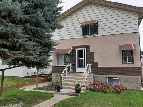 Land with Building(s) For Sale in Edmonton, AB - 4 bdrm, 2.5 bath (9342 74 Ave)
