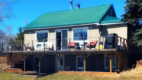 House / Cottage / Recreational Property / Waterfront Property For Sale in Camrose County, AB - 2+1 bdrm, 1 bath (1707 Pelican Point Drive)